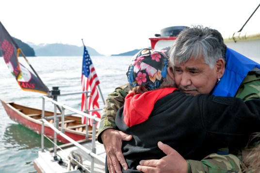 Members of the One People Canoe Society share a hug before hopping into canoes to finish paddling from Angoon to Juneau on Wednesday, June 8, 2016, near Juneau, Alaska. The society began the trip on June 2. Their landing on Douglas Island is the unofficial beginning of Celebration. (Photo by Rashah McChesney/KTOO)