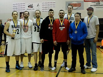 B-Bracket all-tourney selections Kyle Fossman (MVP), Kyle Rush, Tyler Healy, Brian Koening, David Lindstrom, Ben Egolf, Vinny Edenshaw, and Clayton Edwin (not pictured Eric James, Ryan Howell) at the Juneau Lions Club 71st Annual Gold Medal Basketball Tournament at Juneau-Douglas High School on Saturday. (Photo courtesy Klas Stolpe)