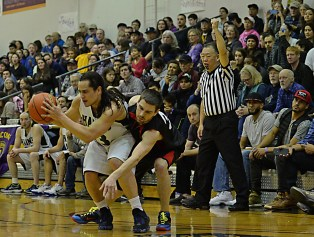 Referee Craig Tamaki calls a foul during the B-Bracket championship of the Juneau Lions Club 71st Annual Gold Medal Basketball Tournament at Juneau-Douglas High School on Saturday. (Photo courtesy Klas Stolpe)