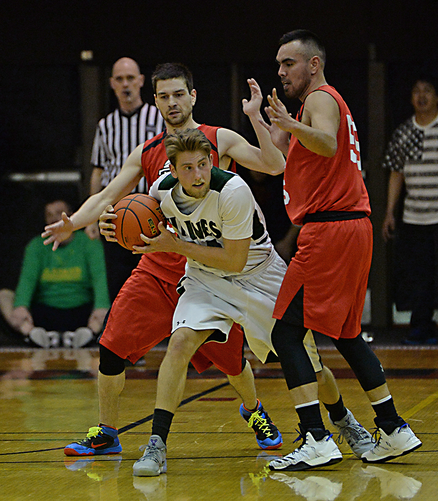 Haines' Orion Falvey is defended by Hoonah's Devin Moritz and David Lindstrom during their B-Bracket semifinal in the Juneau Lions Club 71st Annual Gold Medal Basketball Tournament at Juneau-Douglas High School on Thursday. Haines won 77-63. (Photo courtesy Klas Stolpe)
