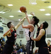 Yakutat's Josh James shoots against Hoonah's Brian Koenig (5) and George Fisher during Hoonah's 69-63 win in a B-bracket game at the Juneau Lions Club 71st Annual Gold Medal Basketball Tournament on Sunday, March 19, 2017. (Photo courtesy Klas Stolpe)