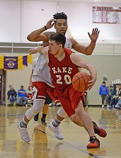 Kake's Tracy Jackson (20) dribbles past Angoon defender JJ Jack-Nixon (3) during Kake's 86-73 win on Sunday, March 19, 2017, at the Juneau Lions Club 71st Annual Gold Medal Basketball Tournament. (Photo courtesy Klas Stolpe)