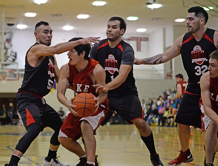 A Kake player secures a rebound as Hoonah players defend in a B-Bracket game of the Juneau-Lions Club 71st Annual Gold Medal Basketball Tournament at Juneau-Douglas High School on Monday. Hoonah won 61-57. (Photo courtesy Klas Stolpe)