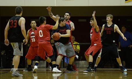 Wrangell's Spencer Stavee is defended by Hoonah players during their B-Bracket elimination game in the Juneau Lions Club 71st Annual Gold Medal Basketball Tournament at Juneau-Douglas High School on Friday. Hoonah won 85-77. (Photo courtesy Klas Stolpe)