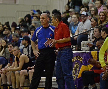 Hoonah coach Louie White Sr. pleads his case with referee Erick Johnson during his team's B-Bracket eliminaton game against Wrangell in the Juneau Lions Club 71st Annual Gold Medal Basketball Tournament at Juneau-Douglas High School on Friday. Hoonah won 85-77. (Photo courtesy Klas Stolpe)