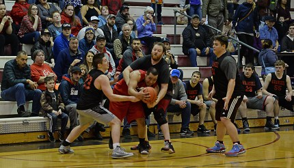 Wrangell players defend Hoonah's Jaylin Prince during their B-Bracket elimination game in the Juneau Lions Club 71st Annual Gold Medal Basketball Tournament at Juneau-Douglas High School on Friday. Hoonah won 85-77. (Photo courtesy Klas Stolpe)