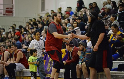 Wrangell's Jason Clark congratulates Hydaburg's Sebastian Bowker on his efforts after Bowker fouled out during a B-Bracket elimination game in the Juneau Lions Club 71st Annual Gold Medal Basketball Tournament at Juneau-Douglas High School on Wednesday. Wrangell won 87-68. (Photo courtesy Klas Stolpe)