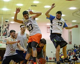 Wrangell's Spencer Stavee (23) ducks under the defense of Metlakatla's Franklin Hayward (23) and Tristan Winter (13) in B-bracket action in the Juneau Lions Club 71st Annual Gold Medal Basketball Tournament at JDHS on Sunday, March 19, 2017. Wrangell won 84-81. (Photo courtesy Klas Stolpe)