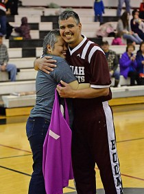 Albert Hinchman, representing the Hoonah Masters team, presented breast-cancer survivor Cristina Dybdahl an honorary team jersey prior to play on Monday at the Juneau Lions Club 71st Annual Gold Medal Basketball Tournament at Juneau-Douglas High School. (Photo courtesy Klas Stolpe)