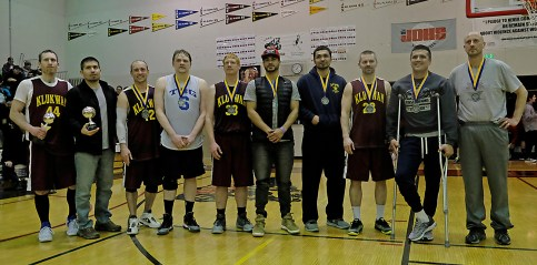 C-Bracket all tourney selections Andrew Friske (MVP), Kamal Lindoff (Sportsmanship), Jason Shull, Sean Joslyn, Jessie McGraw, Martin Sensmeier, Willie Hayward, Michael Ganey, Anthony Lindoff, and Jim Carson at the Juneau Lions Club 71st Annual Gold Medal Basketball Tournament at Juneau-Douglas High School on Saturday. (Photo courtesy Klas Stolpe)