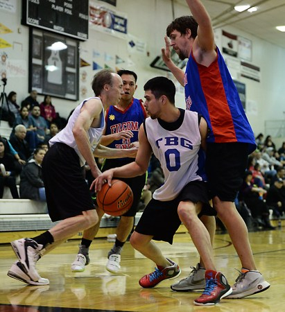 James Gang's Billy Elhyers (0) is defended by Filcom's Mike Vanderjack during Filcom's 59-51 win in a C Bracket game of the Juneau Lions Club 71st Annual Gold Medal Basketball Tournament at JDHS on Sunday, March 19, 2017. (Photo courtesy Klas Stolpe)