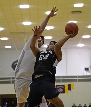 Angoon's Guy Hunter attempts a shot against Hoonah's David Lindoff during their C-Bracket elimination game at the Juneau Lions Club 71st Annual Gold Medal Basketball Tournament at Juneau-Douglas High School on Tuesday. Hoonah won 88-66. (Photo courtesy Klas Stolpe)