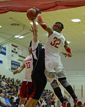Hoonah's Author Campbell (32) blocks a shot by Angoon's Frank Lane during their C-Bracket elimination game at the Juneau Lions Club 71st Annual Gold Medal Basketball Tournament at Juneau-Douglas High School on Tuesday. Hoonah won 88-66. (Photo courtesy Klas Stolpe)