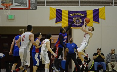 Hoonah's Michael Schneeberger (33) shoots over Filcom's Rob Ridgeway (4) during their C-Bracket elimination game in the Juneau Lions Club 71st Annual Gold Medal Basketball Tournament at Juneau-Douglas High School on Wednesday. Hoonah won 66-62. (Photo courtesy Klas Stolpe)