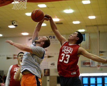 Kake's Josh Jackson (33) blocks Juneau James Gang's Sean Smith during their C-bracket elimination game at the Juneau Lions Club 71st Annual Gold Medal Basketball Tournament at Juneau-Douglas High School on Tuesday. James Gang won 88-52. (Photo courtesy Klas Stolpe)