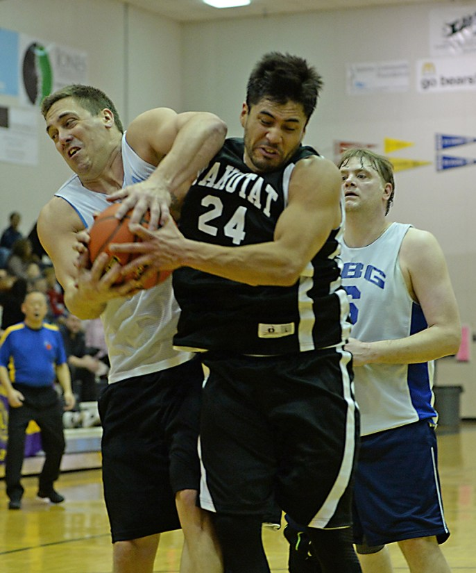 James Gang's Russ Stevens (44) and Yakutat's Martin Sensmeier (24) battle for a rebound in a C-Bracket elimination game in the Juneau Lions Club 71st Annual Gold Medal Basketball Tournament at Juneau-Douglas High School on Wednesday. James Gang won 70-62. (Photo courtesy Klas Stolpe)