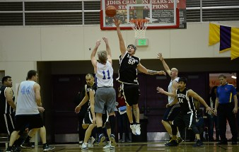 James Gang's Doug Drazkowski (11) shoots over Yakutat's Shane Brown (50) in a C-Bracket elimination game in the Juneau Lions Club 71st Annual Gold Medal Basketball Tournament at Juneau-Douglas High School on Wednesday. James Gang won 70-62. (Photo courtesy Klas Stolpe)
