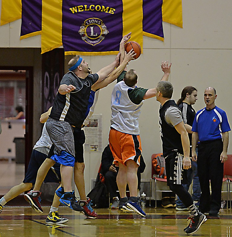 Metlakatla and Jame Gang players go for a rebound during their C-Bracket elimination game in the Juneau Lions Club 71st Annual Gold Medal Basketball Tournament at Juneau-Douglas High School on Friday. James Gang won 84-74. (Photo courtesy Klas Stolpe)