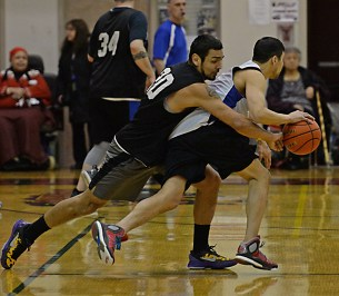 Metlakatla's Willie Hayward (20) steals the ball from James Gang's Billy Ehlers during their C-Bracket elimination game in the Juneau Lions Club 71st Annual Gold Medal Basketball Tournament at Juneau-Douglas High School on Friday. James Gang won 84-74. (Photo courtesy Klas Stolpe)