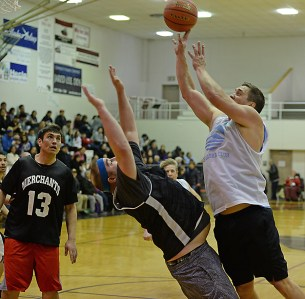 Metlakatla's Gabe Duckworth tries to draw a charging foul on James Gang's Russ Stevens during their C-Bracket elimination game in the Juneau Lions Club 71st Annual Gold Medal Basketball Tournament at Juneau-Douglas High School on Friday. James Gang won 84-74. (Photo courtesy Klas Stolpe)