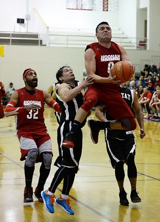 Hoonah's Anthony Lindoff (0) scores against Yakutat in a C Bracket game of the Juneau Lions Club 71st Annual Gold Medal Basketball Tournament at JDHS on Sunday, March 19, 2017. Yakutat won 62-59. (Photo courtesy Klas Stolpe)
