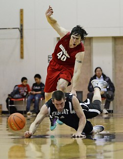 Yakutat's Jimmy Jensen (24) is fouled by Hoonah's Donald Dybdahl (40) in a C Bracket game of the Juneau Lions Club 71st Annual Gold Medal Basketball Tournament at JDHS on Sunday, March 19, 2017. Yakutat won 62-59. (Photo courtesy Klas Stolpe)