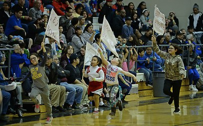 Hoonah fans run flags around the gym during the Womens Bracket elimination game between Hoonah and Angoon in the Juneau Lions Club 71st Annual Gold Medal Basketball Tournament at Juneau-Douglas High School on Wednesday. Hoonah won 47-45. (Photo courtesy Klas Stolpe)