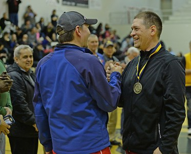 Kake's Lloyd Davis congratulates brother Nick Davies after giving him the Gold Medal Hall of Fame inductee's medal at the Juneau Lions Club 71st Annual Gold Medal Basketball Tournament at Juneau-Douglas High School on Friday. (Photo courtesy Klas Stolpe)