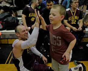 A high-five after the C-Bracket championship at the Juneau Lions Club 71st Annual Gold Medal Basketball Tournament at Juneau-Douglas High School on Saturday. (Photo courtesy Klas Stolpe)