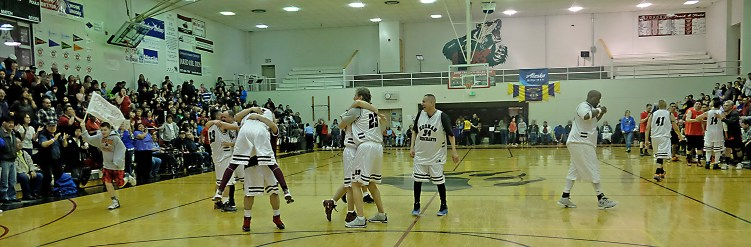Hoonah players celebrate their win over Kake in the Master's Bracket championship at the Juneau Lions Club 71st Annual Gold Medal Basketball Tournament at Juneau-Douglas High School on Saturday. Hoonah won 80-78. (Photo courtesy Klas Stolpe)
