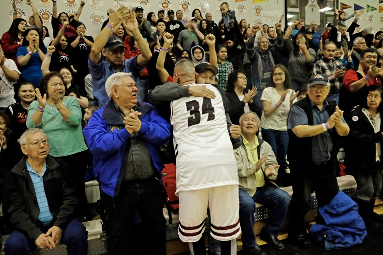 Hoonah's James Mercer (34) celebrates with fans after the Master's Bracket championship of the Juneau Lions Club 71st Annual Gold Medal Basketball Tournament at Juneau-Douglas High School on Saturday. Hoonah beat Kake 80-78. (Photo courtesy Klas Stolpe)