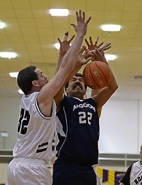 Hoonah's John Thein Jr. (32) stops a shot by Angoon's Edward Jack (22) during their Masters Bracket elimination game at the Juneau Lions Club 71st Annual Gold Medal Basketball Tournament at Juneau-Douglas High School on Thursday. Hoonah won 94-67. (Photo courtesy Klas Stolpe)