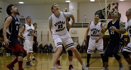 Angoon and Hoonah players wait for a rebound during their Masters Bracket elimination game at the Juneau Lions Club 71st Annual Gold Medal Basketball Tournament at Juneau-Douglas High School on Thursday. Hoonah won 94-67. (Photo courtesy Klas Stolpe)