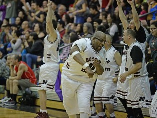 Hoonah's Tierney Bible celebrates a score during the Master's Bracket championship of the Juneau Lions Club 71st Annual Gold Medal Basketball Tournament at Juneau-Douglas High School on Saturday. Hoonah beat Kake 80-78. (Photo courtesy Klas Stolpe)