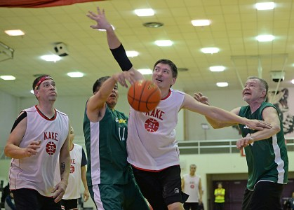 Kake's Lloyd Davis (21) and Sitka's Ray Kitka (11) rebound during their Masters Bracket elimination game in the Juneau Lions Club 71st Annual Gold Medal Basketball Tournament at Juneau-Douglas High School on Wednesday. Kake won 67-51. (Photo courtesy Klas Stolpe)