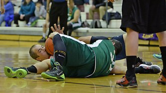 Kake and Sitka players battle for a loose ball during their Masters Bracket elimination game in the Juneau Lions Club 71st Annual Gold Medal Basketball Tournament at Juneau-Douglas High School on Wednesday. Kake won 67-51. (Photo courtesy Klas Stolpe)