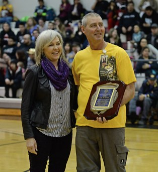 Steve Brandner stands with his wife, Monica, after receiving the Walter A. Soboleff Achievement Award at the Juneau Lions Club 71st Annual Gold Medal Basketball Tournament on Saturday. (Photo courtesy Klas Stolpe).