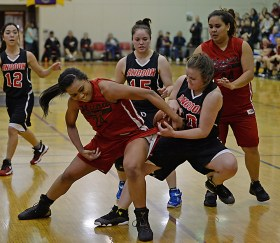 Hoonah's Taryn White (24) and Angoon's Vivian Croasmun (20) battle for a rebound during their Womens Bracket elimination game in the Juneau Lions Club 71st Annual Gold Medal Basketball Tournament at Juneau-Douglas High School on Wednesday. Hoonah won 47-45. (Photo courtesy Klas Stolpe)