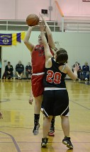 Hoonah's Mariah White (23) shoots over Angoon's Vivian Croasmun (20) during their Womens Bracket elimination game in the Juneau Lions Club 71st Annual Gold Medal Basketball Tournament at Juneau-Douglas High School on Wednesday. Hoonah won 47-45. (Photo courtesy Klas Stolpe)