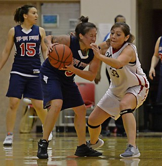 Yakutat's Kim Buller (5) is fouled by Hoonah's Krissy Bean (33) during their Womens Bracket elimination game in the Juneau Lions Club 71st Annual Gold Medal Basketball Tournament at Juneau-Douglas High School on Friday. Hoonah won 56-53. (Photo courtesy Klas Stolpe)