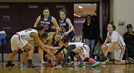 Hoonah and Yakutat players scramble for a loose ball during their Womens Bracket elimination game in the Juneau Lions Club 71st Annual Gold Medal Basketball Tournament at Juneau-Douglas High School on Friday. Hoonah won 56-53. (Photo courtesy Klas Stolpe)