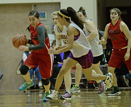Hoonah's Melissa Fisher (1) dribbles up court against Haines during a Women's Bracket game at the Juneau Lions Club 71st Annual Gold Medal Basketball Tournament at Juneau-Douglas High School on Tuesday. Haines won 62-55. (Photo courtesy Klas Stolpe)