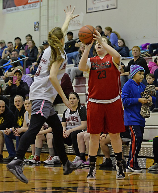 Haines' Lisa Shove (5) contests a shot by Hoonah's Mariah Martin (23) during the Women's Bracket championship of the Juneau Lions Club 71st Annual Gold Medal Basketball Tournament at Juneau-Douglas High School on Saturday. Haines won 52-30. (Photo courtesy Klas Stolpe)
