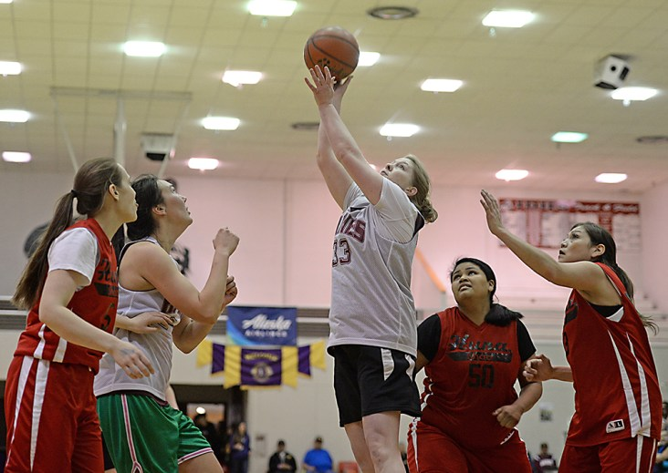 Haines' Sabrina Sticker (33) scores against Hoonah during the Women's Bracket championship of the Juneau Lions Club 71st Annual Gold Medal Basketball Tournament at Juneau-Douglas High School on Saturday. Haines won 52-30. (Photo courtesy Klas Stolpe)