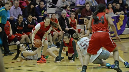 Hoonah's Alice Johnson (5) secures a loose ball against Haines during the Women's Bracket championship of the Juneau Lions Club 71st Annual Gold Medal Basketball Tournament at Juneau-Douglas High School on Saturday. Haines won 52-30. (Photo courtesy Klas Stolpe)