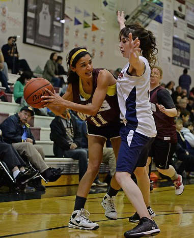 Haines' Stoli Lynch (11) is defended by Yakutat's Katrina Fraker during their Womens Bracket semifinal in the Juneau Lions Club 71st Annual Gold Medal Basketball Tournament at Juneau-Douglas High School on Thursday. Haines won 65-52. (Photo courtesy Klas Stolpe)
