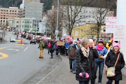 Protesters march down Main Street in downtown Juneau on Jan. 20, 2018. (Photo by Adelyn Baxter/KTOO)