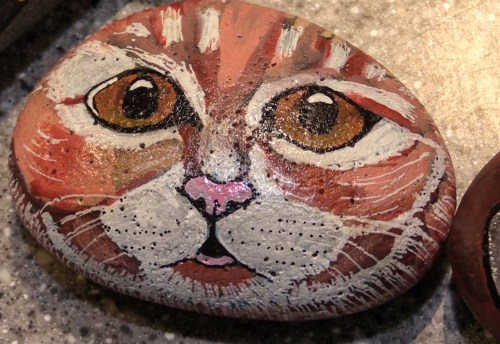 A rock painted like a cat by Heather Stemmerman (Photo by David Purdy/KTOO)