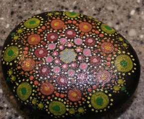 A rock painted with an abstract pattern by Heather Stemmerman (Photo by David Purdy/KTOO)