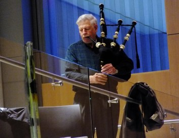 Bagpiper Rai Behnart performs at Father Andrew P. Kashevaroff State Library, Archives and Museum.